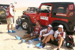 Team Nike resting in the shade of a Jeep on yesterday's trek.