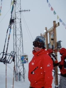 Looking a little preggo with skins under my jacket atop Highlands Bowl.